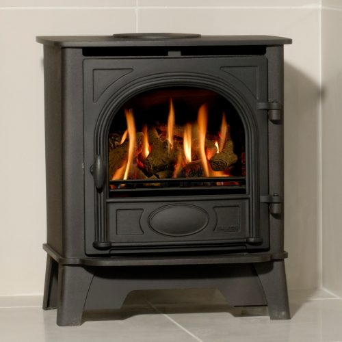 With authentic Wood Burning stove styling, right down to the hinged door with handle, the Gazco Stockton 5, Log Effect, LPG Gas, Balanced Flue Stove is conveniently sized between the Gazco small and medium gas stove models.